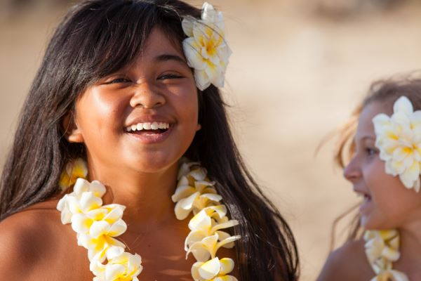Young girl wearing a Hawaiian lei of plumeria flowers