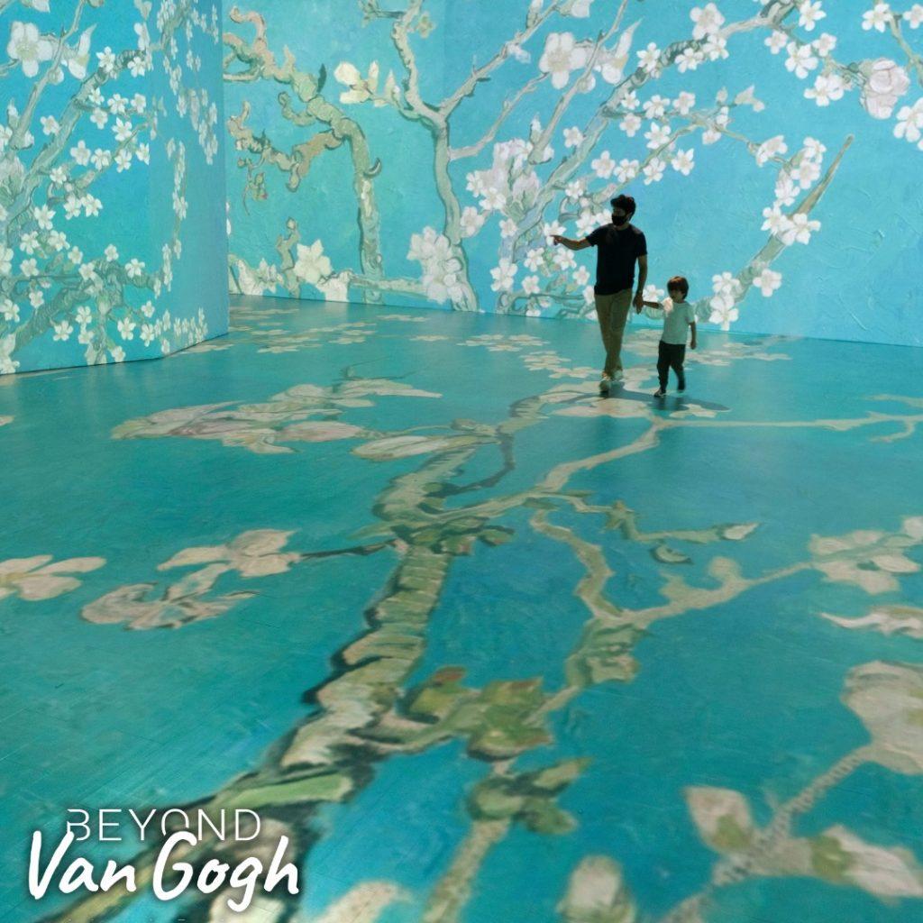 Beyond Van Gogh exhibit image - blossoming trees