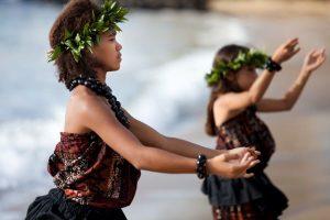 Hawaiian hula dancers on the shore