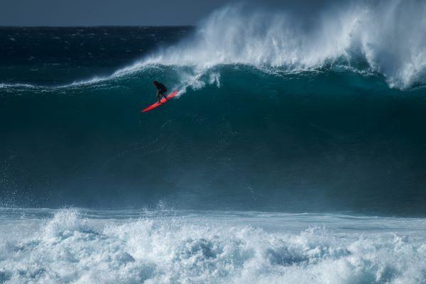 big wave surfer at Waimea Bay on Oahu North Shore in Hawaii