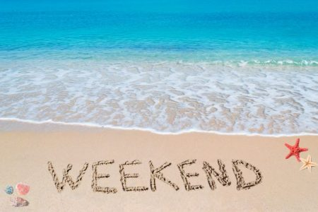 """""""weekend"""" written in the sand on a tropical beach"""