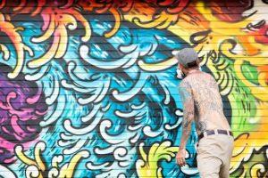Pow Wow Hawaii Graffiti Mural by Marko Livingston, tattoo artist in Honolulu