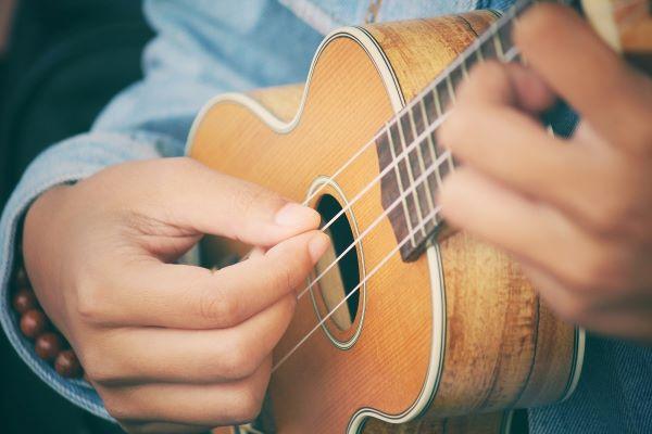playing ukulele string instrument