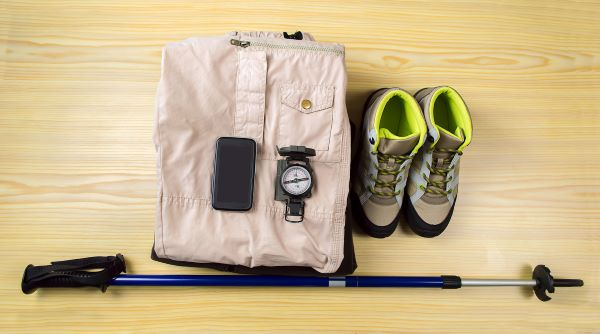 hiking equipment (poles, boots cellphone, compass, clothing)