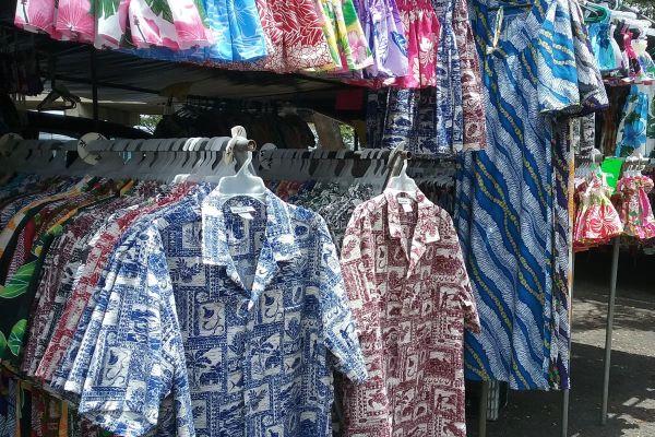 Racks of Hawaiian shirts and dresses for sale