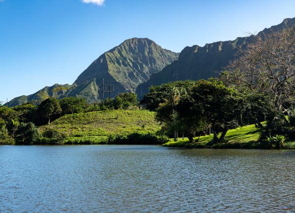 Mountain ridge rises above Hoomaluhia Botantical Gardens on Oahu
